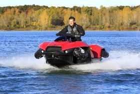 The Quadski, a personal watercraft that also drives up to 45 mph on land. (Photo by Carlos Osorio / AP)