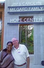 Dr. Sherwin Shinn with his wife, Faria, outside the Boys and Girls Club Center in Gig Harbor where he practices at Lindquist Dental Clinic for Children. (Photo courtesy Dr. Sherwin Shinn)