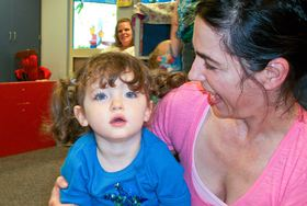 A program called High 5 is specifically geared for children with autism. For 2- and 3-year-olds, High 5 includes a developmental play class, and parents take turns helping in the classroom. (Photo by Holly Ridge Center)