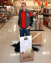 Brendon Bottle, Americorps team member from the American Red Cross, collects donations at the East Bremerton Grocery Outlet. (Photo courtesy Red Cross)