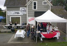 Diners line up for a special lunch buffet at Bainbridge Island BBQ on March 15, the last day the restaurant was open.