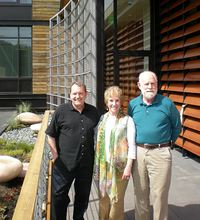 Executive director Greg Robinson, museum founder Cynthia Sears and board president Chris Snow stand on the patio next to the rooftop garden at the Bainbridge Island Museum of Art.
