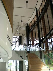 The open staircase in the museum's two-story atrium leads to the Beacon Gallery on the second-floor landing.