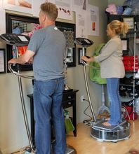 Kitsap Lake Storage owners Chuck and Patty Bair are shown using the Proellixe vibration fitness machines they installed for customers to use at their business.