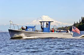Tourists on a cruise with Destiny Harbor Tours out of Gig Harbor explore the waters of Puget Sound and take in stunning views of Mount Rainier. (Photo by Jan's Marine Photography)
