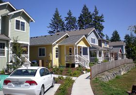 Homes in the Ferncliff Village development on Bainbridge Island are designed to be affordable and have a small housing footprint. A community garden is part of Ferncliff, which was developed as a community land trust by the nonprofit Housing Resources Board.