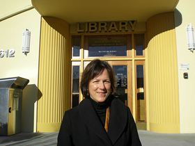 Cover Story: Jaime Forsyth stands in front of the downtown Bremerton library. She brings an unusually broad range of experience to her new job as executive director of the Kitsap Regional Library Foundation.