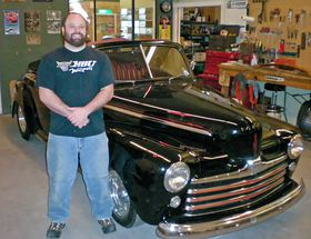 Chris Grasser knows a lot about revving up hot rods and restoring classic cars, and that was before the owner of HMS Customs in Poulsbo went to college to get a degree with a dual major.