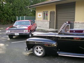 A 1967 Chevelle and a 1947 Ford convertible are two of the classic cars Chris Grasser is working on at HMS Customs in Poulsbo.