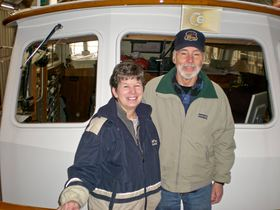 Mike and Billie Henry on their boat Peachy Keen at the Bremerton Yacht Club.