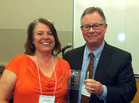 KEDA's John Powers with Lynn Longan of the state Department of Commerce's Associate Development Organization at the awards presentation in Tacoma.