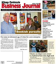 Cover Story: Randy Kuckuck, left, stands by a display of book covers at Publish Next in Poulsbo with marketing director Trudy Catterfeld and editor Trey Schorr.