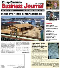 Cover Story: Crews work on the upper frame of a clear story skylight on the roof of the building on Bay Street where the Port Orchard Public Market is being built.