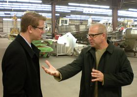 Scott Peterson, right, CEO of SAFE Boats International, talks with U.S. Rep. Derek Kilmer during a Jan. 18 tour of the company's manufacturing facility in Bremerton.