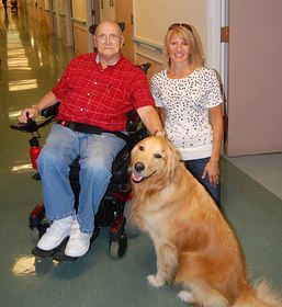 Poncho, a friendly golden retriever, is a favorite visitor for Darrell Rice and other residents when trainer Kari MacKenzie brings him to the Martha & Mary long-term care center in Poulsbo. (Photo courtesy Martha & Mary)