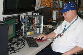 Larry DuSavage works on a computer that was donated to New Horizons for refurbishing.