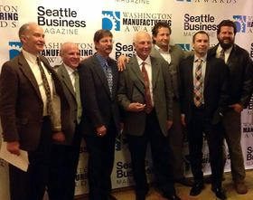 Jim Brandt, center, and Jon Brandt, third from right, are shown with some of their senior staff from Ozone International at a recent awards banquet when the company was honored as Seattle Business magazine's 2013 Manufacturer of the Year.