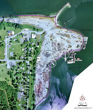 The circles on this aerial photo of the Port Gamble mill site show the two docks in question in a disagreement between Pope Resources and the state Ecology Department over completion of the cleanup at the site on Port Gamble Bay. (Pope Resources Photo)