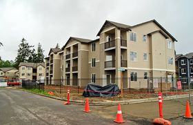 The Sydney complex of eight apartment buildings is nearing completion in Port Orchard. The 106-unit development built by Rush Cos. of Gig Harbor is behind a small commercial center at the northwest corner of Sidney and Sedgwick roads.