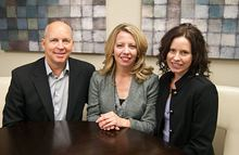 Rick and Heather Slate with Carrie Abernathy, center, are the principals in Sterling Property Group in Silverdale.