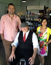 James Harris, center, who opened Sugardaddy's salon in 2005 in downtown Port Orchard, and his partner Tim Waibel are making a long-planned move to London in September. Their goal is to eventually open a new styling salon there. Jessica Tudela will be salon manager at Sugardaddy's.