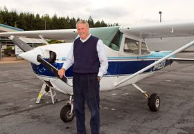 Tim Thomson doesn't own an airplane — and doesn't plan to after retirement — but he's had the chance to keep flying this airplane (and others) several times a year as part of his job as Port of Bremerton CEO. (Rodika Tollefson Photo)