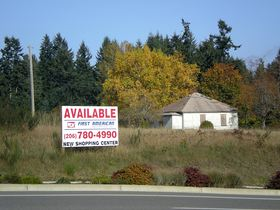 The area along Greaves Way just west of State Route 3 could see the start of new commercial development next spring on Silverdale's north side. CenterCal Properties has plans to build a shopping center on the south side of Greaves Way, in an area Kitsap County rezoned as the Waaga Way Town Center when the $13 million connector road was built in 2009.