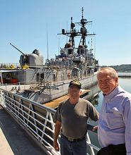 Jerry McDonald, right, stands with Steve Boerner, director of the Bremerton Historic Ship Association, in front of the USS Turner Joy on the Bremerton waterfront.