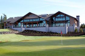 The new clubhouse at White Horse Golf Club overlooks the 18th green.
