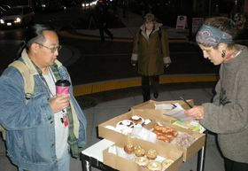 Baker Erika Anderson sells dPio Bakery pastries to shipyard workers early on a recent Friday morning at the corner of Fourth Street and Park Avenue in Bremerton.