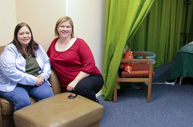 Kitsap Birth Collective co-founders Kendra Machen, left, and Joanna Bennett sit outside of the massage therapy room, which can also be used for consultations. (Rodika Tollefson photo)