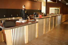 The Coffee Oasis was set to open its new location on Bay Street in Port Orchard on March 1, after months of efforts by volunteers to renovate the former Bay Street Ale House building. Jesse Westwood, shown at the service counter, will manage the café operation and there will be a separate youth center on the second floor.