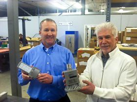 Bob Nietfield, left, new VP for sales at Differential Energy Global, and company owner Rick Flaherty hold high-tech LED replacement bulbs at DEG's production facility in Port Orchard. (Tim Kelly Photo)