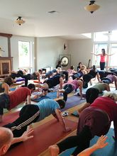 Instructor Jeny Vidal leads a large group in a yoga class on Nov. 2, the first day Dayaalu Center was open for classes in its new location at a remodeled house on Bainbridge Island. (Photo courtesy Dayaalu Center)