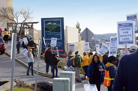 Union-represented professional and technical employees of Harrison Medical Center hold an informational picket outside the hospital in Bremerton on Feb. 19. Negotiations with Harrison for a new contract for nearly 800 workers began last July but have reached an impasse.