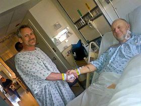 John Rosebeary, right, and Jonathan Ogilvie shake hands at Virginia Mason Medical Center in Seattle the day after Rosebeary's kidney transplant surgery in January to receive Ogilvie's donated organ. (Photo courtesy Rosebeary family)