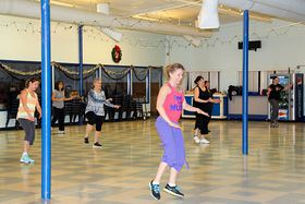 Participants in Kristin Lopez's Zumba class keep up with the music during a recent session. (Rodika Tollefson photo)