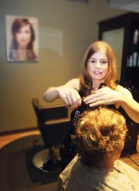 LARRY STEAGALL Stylist Ashley Arnold does a customer's hair at Isella Salon Spa, which recently moved to a new location on Fourth Street in downtown Bremerton.
