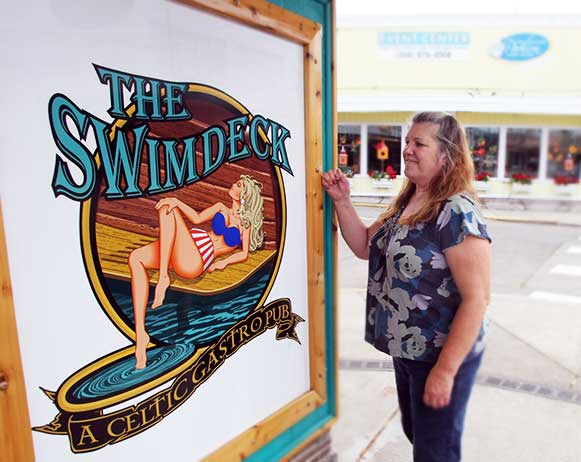 """Swimdeck_Stacy"": Stacy Bronson and her partner, Dave Tagert, recently opened The Swimdeck on Bay Street in Port Orchard. The couple owned another pub in Chehalis that went out of business in June, and they still owe some former employees their final paychecks."